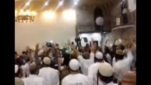 صورة شاشة من فيديو يظهر مشاركين يهود متطرفين في حفل زفاف يحتفلون بقتل عائلة دوابشة (screen capture: Channel 10)