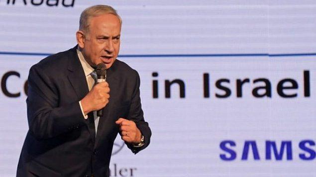 رئيس الوزراء بينيامين نتنياهو يلقي بخطاب في 6 ديسمبر، 2017 خلال مؤتمر دبلوماسي من تنظيم صحيفة 'جيروزاليم بوست' حول علاقات إسرائيل الأمنية والاقتصادية. (AFP PHOTO / MENAHEM KAHANA)