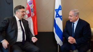 رئيس الوزراء بنيامين نتنياهو يلتقي بنظيره الكرواتي اندري بلينكوفيك في المتدى الاقتصادي العالمي في دافوس، سويسرا، 24 يناير 2018 (Amos Ben-Gershom/GPO)
