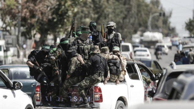 مقاتلي حركة حماس يشاركون في تدريب عسكري في مدينة غزة، 25 مارس 2018 (AFP/ Mahmud Hams)
