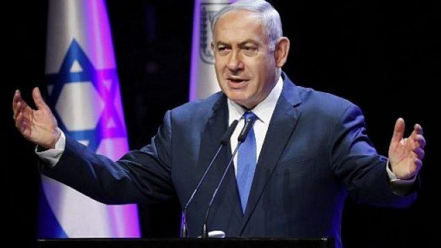 رئيس الوزراء بينيامين نتنياهو يلقي كلمة في مؤتمر الصحة السنوي في تل أبيب، 27 مارس، 2018. (AFP PHOTO / JACK GUEZ)