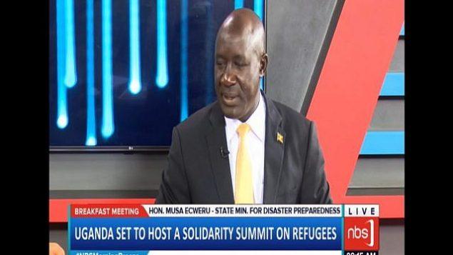 وزير للإغاثة والتأهب للكوارث واللاجئين الأوغندي موسى إيكويرو. (Screen capture: YouTube)