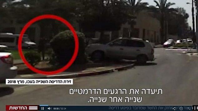 في هذه الصورة المأخوذة من مقطع فيديو، بالإمكان رؤية مالك أسدي وهو يقود مركبته باتجاه جندي في ما يُشتبه بأنه هجوم دهس وقع في مدينة عكا شمالي إسرائيل في 4 مارس، 2018. (Screen capture: Hadashot news)