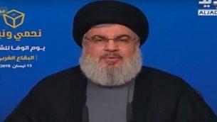 الأمين العام لمنظمة حزب الله، حسن نصر الله، يتحدث عبر الفيديو في تجمع انتخابي في 15 أبريل، 2018. (لقطة شاشة: YouTube)