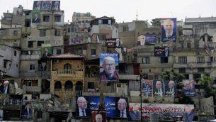 ملصقات دعايات انتخابية للانتخابات البرلمانية اللبنانية على جدران مباني في مدينة طرابلس، شمال لبنان، 3 مايو 2018 (JOSEPH EID / AFP)