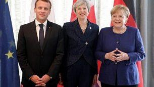الرئيس الفرنسي إيمانويل ماكرون، من اليسار، ورئيسة الوزراء البريطانية تيريزا ماي، في الوسط، والمستشارة الألمانية أنغيلا ميركل، في صورة مشتركة في افتتاح قمة الاتحاد الأوروبي ودول البلقان الغربية في صوفيا، 17 مايو، 2018.  (Ludovic MARIN/AFP)