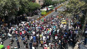 تظاهرات إيرانية في وسط طهران في 25 يونيو، 2018 (AFP Photo/Atta Kenare)
