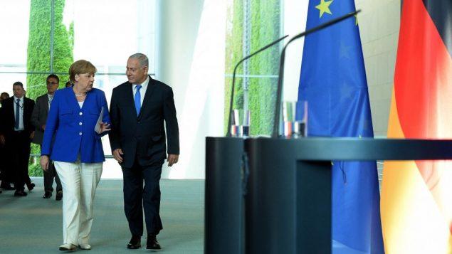 رئيس الوزراء بنيامين نتنياهو والمستشارة الالمانية انغيلا ميركل خلال مؤتمر صحفي مشترك في برلين، 4 يونيو 2018 (Haim Zach/GPO)