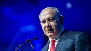 رئيس الوزراء بينيامين نتنتياهو يلقي كلمة خلال مؤتمر 'أسبوع السايبر' في جامعة تل أبيب في 20 يونيو، 2018. (Miriam Alster/Flash90)