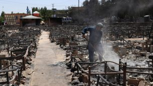 الركام بعد احراق مقاتلين من الطالبان سوق في غزنة الافغانية، 15 اغسطس 2018 (ZAKERIA HASHIMI / AFP)