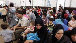 صورة توضيحية للاجئين سوريين، 29 مايو، 2014. (AFP/Anwar Amro)