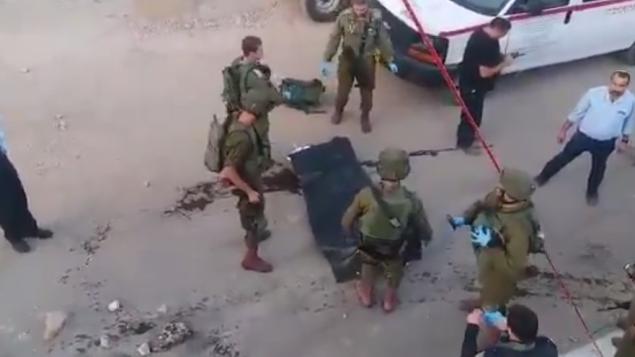 صورة شاشة من فيديو تظهر رجل فلسطيني حاول تنفيذ هجوم طعن في الخليل، 3 سبتمبر 2018
