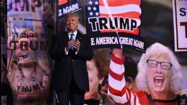 المرشح الرئاسي الجمهوري دونالد ترامب يصل اليوم الأول من المؤتمر الوطني الجمهوري في كليفلاند، أوهايو، 18 يوليو 2016 (AFP/TIMOTHY A. CLARY)