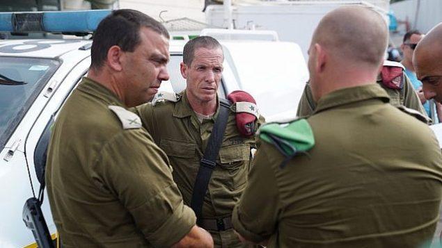قوات الأمن في ساحة هجوم اطلاق نار في مجمع باركان الصناعي في شمال الضفة الغربية، 7 اكتوبر 2018 (Israel Defense Forces)