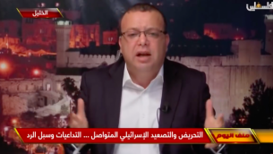 المتحدث باسم فتح أسامة القواسمة يتحدث إلى تلفزيون فلسطين، القناة الرسمية الفلسطينية، في 13 ديسمبر ، 2018. (لقطات شاشة: يوتيوب)