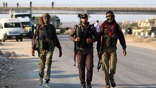مقاتلو معارضة سوريون من محافظة القنيطرة، 21 يوليو 2018 (AFP Photo/Aaref Watad)