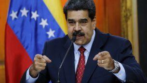 رئيس فنزويلا نيكولاس مادورو خلال مؤتمر صحفي في القصر الرئاسي في كراكاس، فنزويلا، 25 يناير 2019 (AP/Ariana Cubillos)