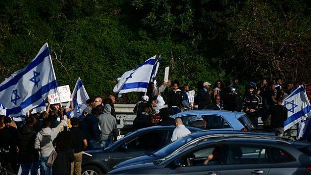 اثيوبيون اسرائيليون يحتجون ضد عنف الشرطة في تل ابيب، 30 يناير 2019 (Tomer Neuberg/Flash90)