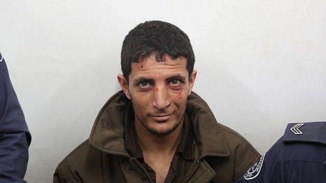 عرفات ارفاعية، المتهم بقتل الفتاة الإسرائيلي أوري أنسباخر (19 عاما)، يمثل أمام محكمة الصلح في القدس، 11 فبراير، 2019.  (Yonatan Sindel/Flash90)