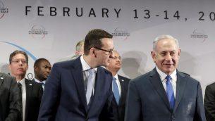 رئيس الوزراء البولندي ماتيوش مورافيسكي ورئيس الوزراء بنيامين نتنياهو خلال مؤتمر السلام والامن في الشرق الاوسط، في وارسو، بولندا، 14 فبراير 2019 (AP Photo/Michael Sohn)