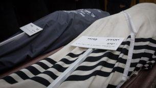 تشييع جقمان يهودا وتمار كدوري في القدس، 14 يناير 2019 (Noam Revkin Fenton/Flash90)