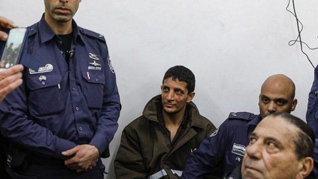 عرفات ارفاعية (29 عاما)، الفلسطيني المشتبه بقتل فتاة إسرائيلية، يمثل أمام محكمة الصلح في القدس في 11 فبراير، 2019. (MENAHEM KAHANA / AFP)