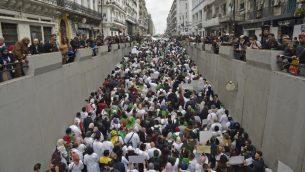جزائريون يتظاهرون في الجزائر العاصمة ضد الرئيس عبد العزيز بوتفليقة، 19 مارس 2019 (RYAD KRAMDI / AFP)