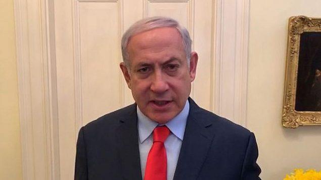 لقطة شاشة من مقطع فيديو باللغة العبرية نشره متكتب رئيس الوزراء من واشنطن في 25 مارس، 2019، يعلن فيه رئيس الوزراء  للإسرائيليين عن عودته إلى البلاد عقب هجوم صاروخي من غزة في وقت سابق من اليوم.  (Courtesy PMO)