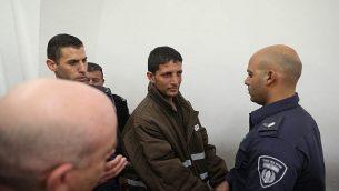 عرفات ارفاعية (29 عاما)، الفلسطيني المشتبه بقتل أوري انسباخر، يمثل أمام محكمة الصلح في القدس في 11 فبراير، 2019. (Yonatan Sindel/Flash90)
