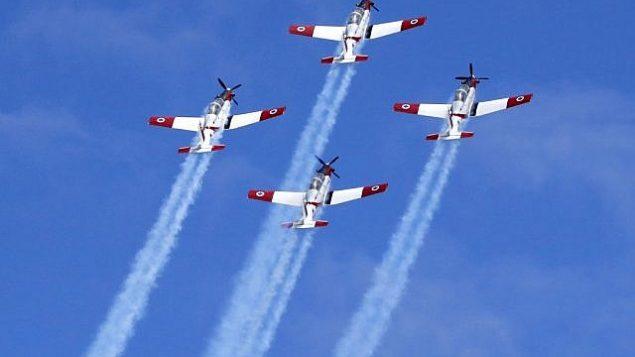 طائرات إسرائيلية من طراز ' Efroni T-6 Texan II' خلال عرض جي فوق الشاطي في مدينة تل أبيب الساحلية، 9 مايو، 2019 في إطار احتفالات إسرائيل بيوم إستقلالها ال71. (JACK GUEZ / AFP)