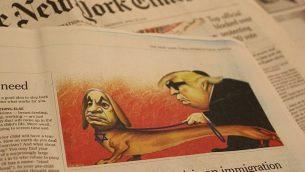 """رسم كاريكاتوري يظهر فيه رئيس الوزراء بنيامين نتنياهو والرئيس الأمريكي دونالد ترامب نشرها في 'نيويورك تايمز' في نسختها الدولية في 25 أبريل، أقرت الصحيفة في وقت لاحق بأنه """"تضمن كليشيهات معادية للسامية"""". (Raoul Wootliff/Times of Israel)"""