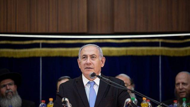 رئيس الوزراء بنيامين نتنياهو يتحدث خلال الاحتفالات ب'يوم القدس' في المعهد الديني 'مركز هراف' في القدس، 2 يونيو، 2019. ( Aharon Krohn/Flash90)