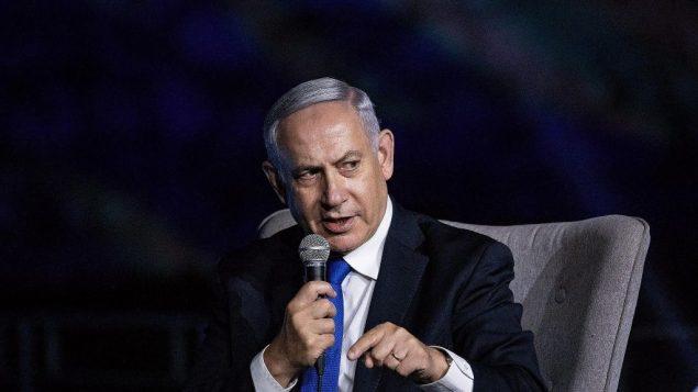رئيس الوزراء بنيامين نتنياهو يتحدث خلال مؤتمر لصحيفة 'يسرائيل هايوم' في القدس، 27 يونيو 2019 (Aharon Krohn/Flash90)