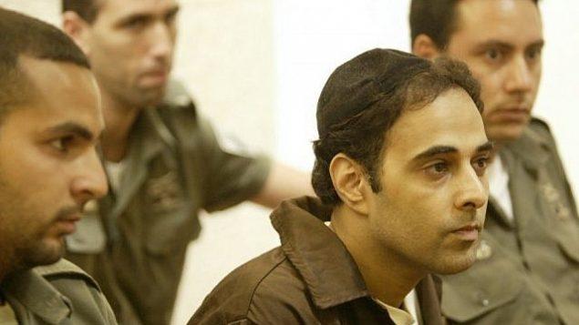 يغال عمير، قاتل رئيس الوزراء يتسحاق رابين، خلال جلسة في المحكمة في عام 2004.  (Yoram Rubin/Flash90)