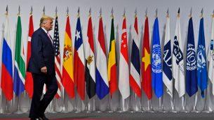 الرئيس الامريكي دونالد ترامب يصل للقاء رئيس الوزراء الياباني شنزو آبي في قمة مجموعة العشرين في اوساكا، السابات، 28 يونيو 2019 (AP Photo/Susan Walsh)
