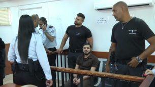حمزة فايز يمثل امام محكمة عوفر العسكرية، 16 يوليو 2018 (Screen capture/Ynet)