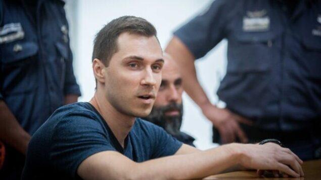 أليكسي بوركوف، هاكر روسي  هاكر روسي من المقرر تسليمه للولايات المتحدة، خلال جلسة في محكمة العدل العليا بالقدس في 3 نوفمبر، 2019. (Yonatan Sindel/Flash90)