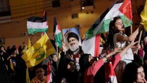مناصرو حزب الله يشاركون في مسيرة لإحياء 'يوم القدس' المناهض لإسرائيل في بيروت، لبنان، 31 مايو، 2019. (AP Photo/Hassan Ammar)