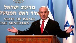 رئيس الوزراء بنيامين نتنياهو يلقي كلمة في مكتبه في القدس، 14 مارس 2020 (GALI TIBBON / POOL / AFP)
