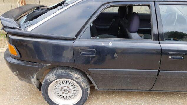 سيارة تم تخريبها فيما يبدو كجريمة كراهية في قرية حوارة الفلسطينية شمال الضفة الغربية، 15 مارس ، 2020. (Yesh Din)