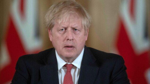 رئيس الوزراء البريطاني بوريس جونسون خلال مؤتمر صحفي حول رد الحكومة على تفشي فيروس كورونا الجديد، داخل 10 داونينج ستريت في لندن، 20 مارس 2020 (JULIAN SIMMONDS / POOL / AFP)