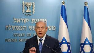 رئيس الوزراء بنيامين نتنياهو يتحدث خلال مؤتمر صحفي حول فيروس كورونا في القدس، 25 مارس،  2020.  (Olivier Fitoussi/Flash90)