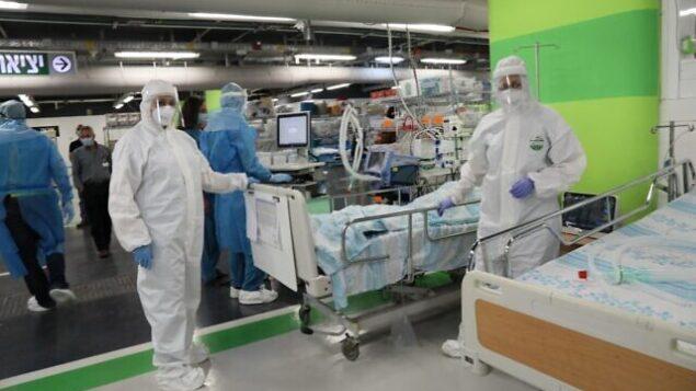 تمرين في  في حرم رمبام للرعاية الصحية في حيفا ، لتحويل موقف السيارات تحت الأرض إلى مركز طوارئ لأعداد كبيرة من مرضى فيروس كورونا.(courtesy of Rambam Health Care Campus)