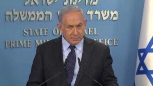رئيس الوزراء بنيامين نتنياهو يخاطب وسائل الإعلام في مؤتمر صحفي في القدس، 15 يوليو 2020 (screenshot)