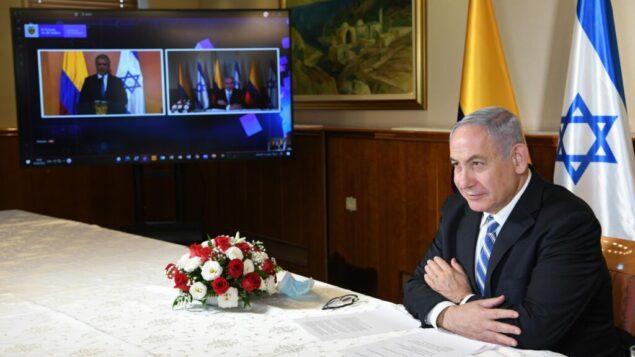 رئيس الوزراء نتنياهو  يشارك عبر الفيديو في حدث بمناسبة المصادقة على اتفاقية التجارة الحرة بين إسرائيل وكولومبيا، 10 أغسطس 2020 (Amos Ben-Gershom / GPO)
