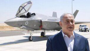 رئيس الوزراء بنيامين نتنياهو يقف أمام طائرة مقاتلة من طراز F-35 في قاعدة 'نيفاطيم' الجوية  في جنوب إسرائيل، في صورة غير مؤرخة. (Amos Ben Gershom / GPO)