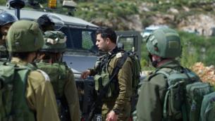 صورة توضيحية: جنود اسرائيليون بالقرب من موقع هجوم اطلاق نار بالقرب من مفرق ارئيل شمال الضفة الغربية، 17 مارس 2019 (Israel Defense Forces)