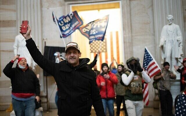 WASHINGTON, DC - JANUARY 06: A pro-Trump mob enters the Roturnda of the U.S. Capitol Building on January 06, 2021 in Washington, DC. Congress held a joint session today to ratify President-elect Joe Biden's 306-232 Electoral College win over President Donald Trump. A group of Republican senators said they would reject the Electoral College votes of several states unless Congress appointed a commission to audit the election results.   Win McNamee/Getty Images/AFP