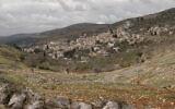 توضيحية: صورة لقرية بورين الفلسطينية بالقرب من مستوطنة هار براخا الإسرائيلية. (Flash90)