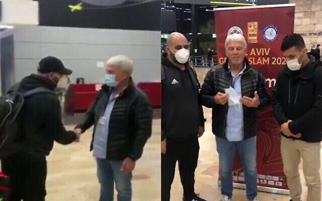موشيه بونتي، رئيس اتحاد الجودو الإسرائيلي يلتقي بالمنشق الإيراني سعيد ملائي في مطار بن غوريون في 14 فبراير، 2021. (Screenshot: Channel 12)